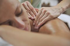 Woman back massage treatment Royalty Free Stock Images