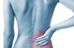 Woman with back pain. Woman holding her painful back Royalty Free Stock Images