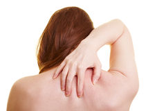 Woman with back pain from behind Stock Photography
