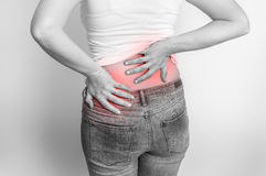 Woman with back pain - black and white photo Stock Image
