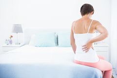 Woman with back pain royalty free stock photos