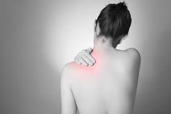 Woman with back pain Stock Image