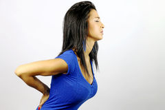 Woman with back pain. Young woman who suffers from back pain Royalty Free Stock Photography