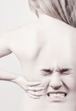 Woman with back pains Royalty Free Stock Photography