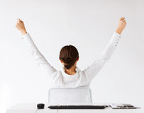 Woman from the back with raised hands Stock Image