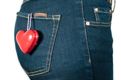 Woman back with red heart in pocket love concept Stock Images