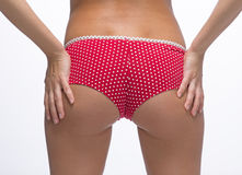 Woman back in red panties Stock Photos