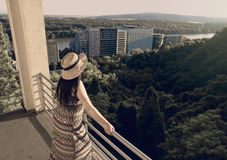 Woman  From Back Standing at Balcony in Sunset Royalty Free Stock Image