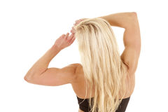 Woman back stretch strong arms. A woman with strong arms is stretching them Stock Photography