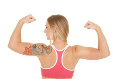 Woman back tattoo flex arms Stock Photo