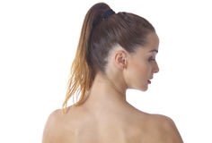 Woman back with tied hair. Beautiful woman back and shouders with casually tied ponytail Stock Photo