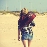 Woman back walking on the beach. In the sunset Stock Photography