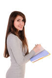 Woman from back, writing, holding notebook organizer in hand and Stock Images