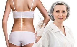 Woman with backache. At the doctor reception over white background Royalty Free Stock Image