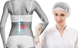 Woman with backache. At the doctor reception over white background Royalty Free Stock Photo
