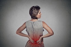 Woman with backache lower back pain colored in red Stock Photos