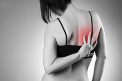 Woman with backache. Pain in the human body Royalty Free Stock Photo