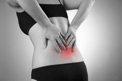 Woman with backache. Pain in the human body Royalty Free Stock Images