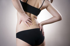 Woman with backache. Pain in the human body royalty free stock photography
