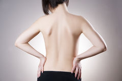 Woman with backache. Pain in the human body Stock Photos