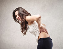 Woman with backache Royalty Free Stock Photos