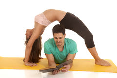 Woman backbend over man reading Stock Photos