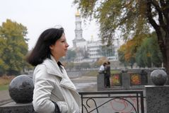 Woman on backgroun church autumn Royalty Free Stock Images
