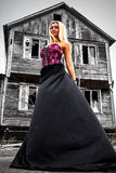 Woman at the background of the abandoned house Royalty Free Stock Photo