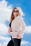 Woman on a background blue sky Stock Photography