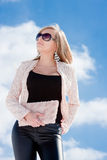 Woman on a background blue sky Royalty Free Stock Image