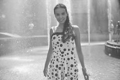 Woman on the background of the fountain in a summer dress Royalty Free Stock Images