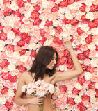 Woman and background full of roses Royalty Free Stock Image