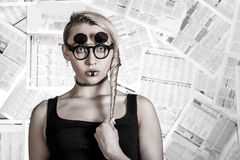 Woman at the background of newspapers Royalty Free Stock Image