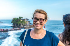Woman on a background of Pura Tanah lot temple, Bali island, Indonesia. Royalty Free Stock Image