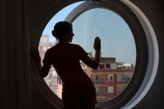 woman on the background of the round window Stock Image