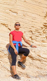 Woman on the background of the sandstone in the desert Stock Photography