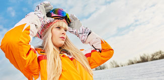 Woman on the background of snow winter and mounts Royalty Free Stock Photography