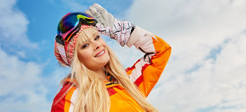 Woman on the background of snow winter and mounts Royalty Free Stock Photos