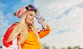 Woman on the background of snow winter and mounts Stock Photo