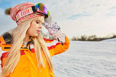 Woman on the background of snow winter and mounts Stock Photos
