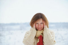 Woman on the background of snowy plains Royalty Free Stock Photo