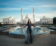 The woman on the background of the white mosque Stock Photos