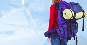 Woman with backpack against digitally generated background with plane taking off. Mid section of woman with backpack against digitally generated background with Royalty Free Stock Images