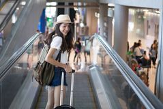 Woman with backpack in airport terminal Stock Photo