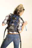 Woman with backpack on from the back look to side stock photos