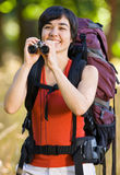 Woman with backpack and binoculars Royalty Free Stock Image