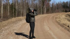 Woman with backpack and binoculars. At outdoor stock footage video stock footage