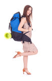 Woman with backpack and carrimat Stock Photo