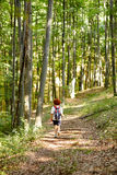 Woman with backpack in the forest Stock Images