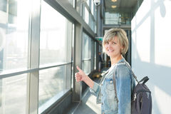 Woman with backpack going on boarding Stock Photos